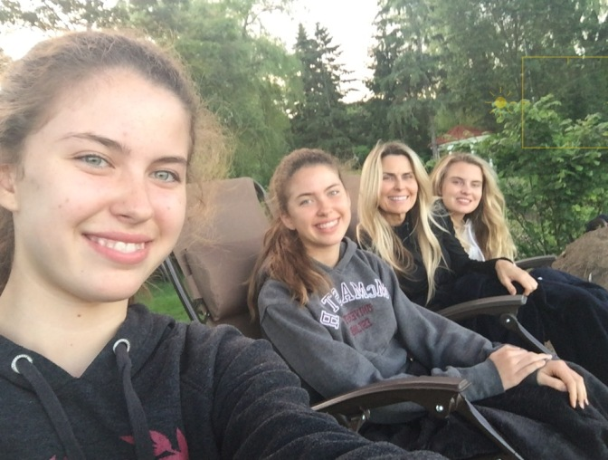 The girls and I cuddling on the cliff
