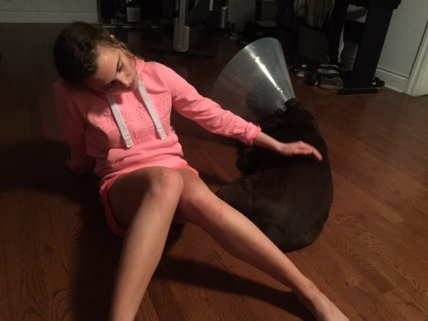 "My daughter and Hershey with the ""cone of shame"""